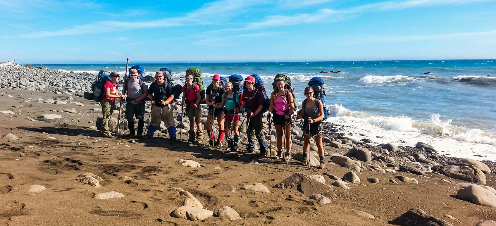 hikers-on-beach