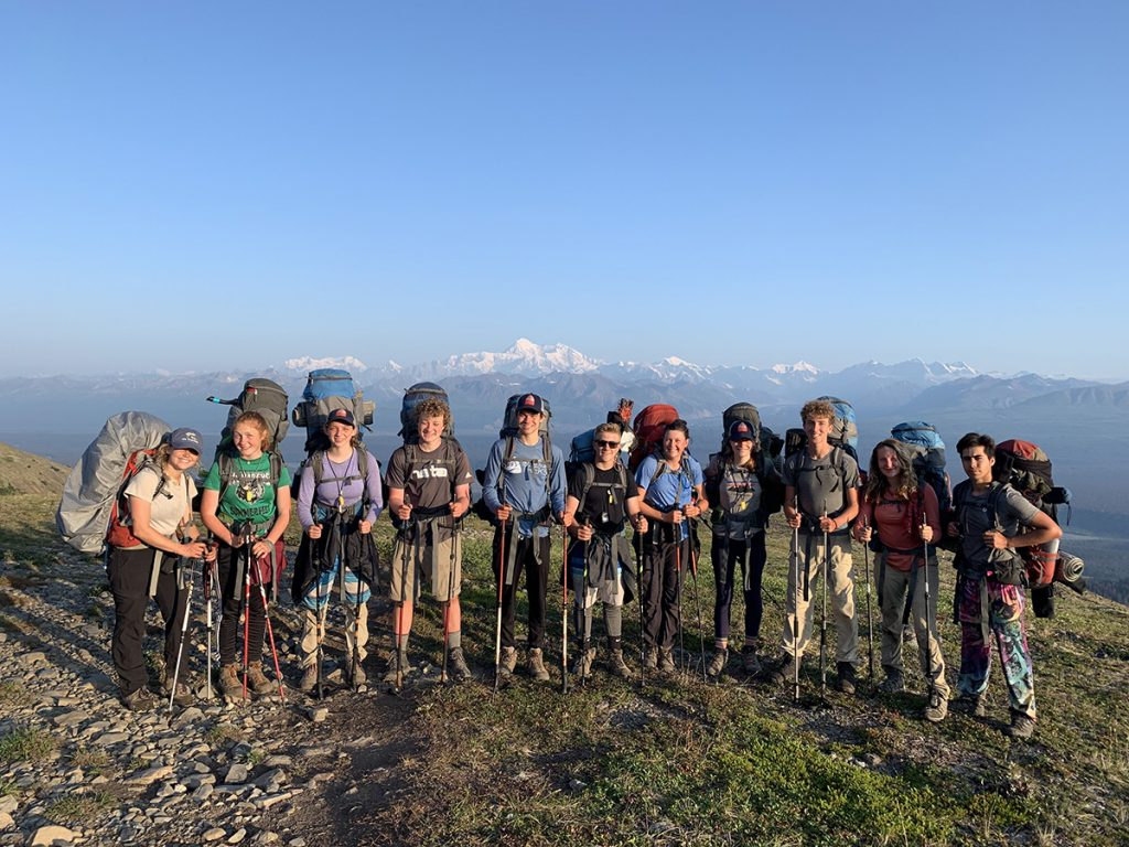 students hiking with backpacks denali mountains