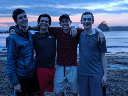 teenage boys backpacking hiking olympic coast washington