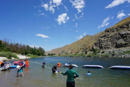 teenagers using water squirt guns on salmon river idaho