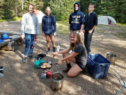 students in yellowstone making lunch