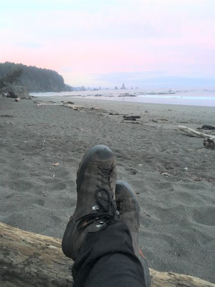 hiking boots on the beach