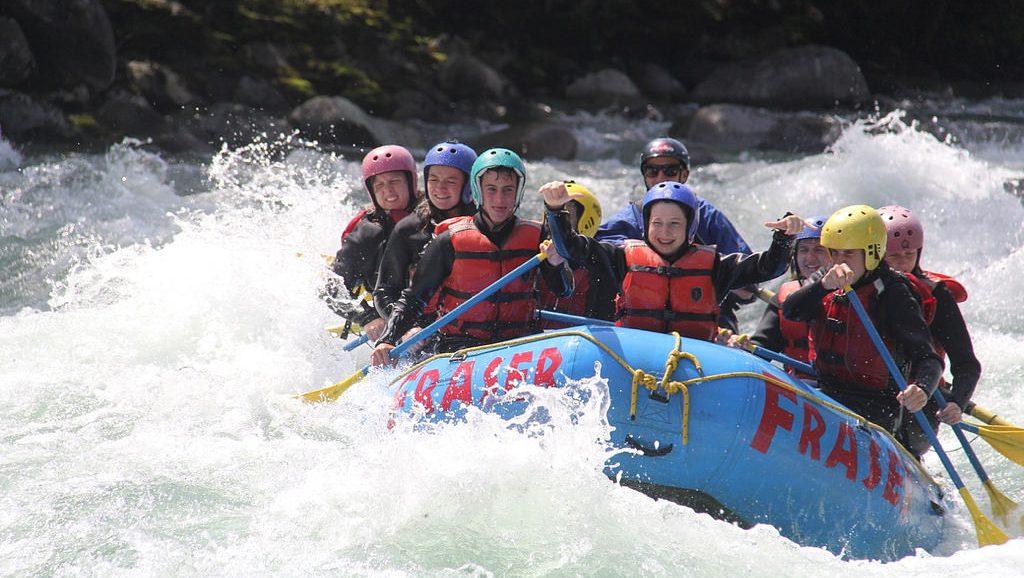teenagers whitewater rafting in british columbia canada