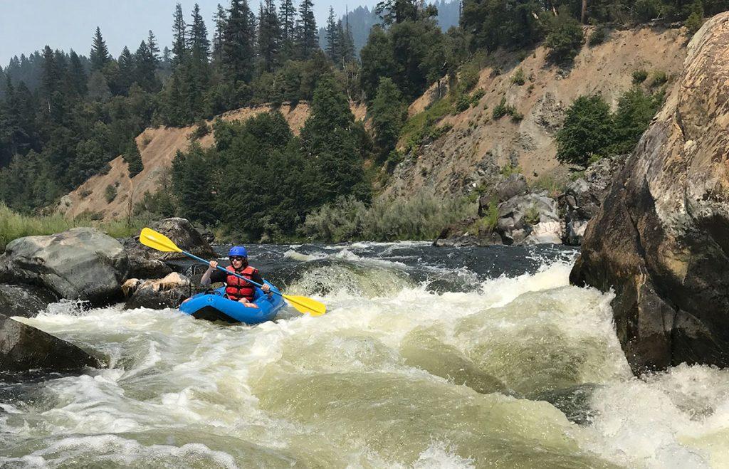 teenage boy inflatable kayaking on middle klamath river