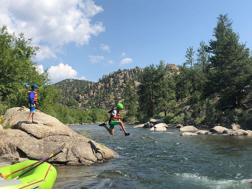 teenage boys jumping into colorado river