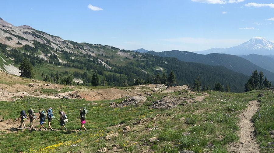 teenagers backpacking in goat rocks wilderness washington