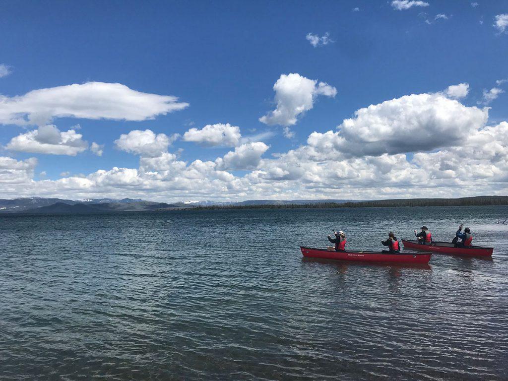 teenagers canoeing on yellowstone lake wyoming