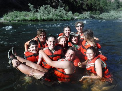 teenagers wearing life jackets in river in california