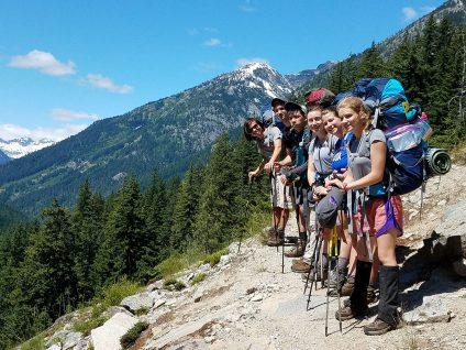 teenagers backpacking and hiking in goat rocks wilderness washington