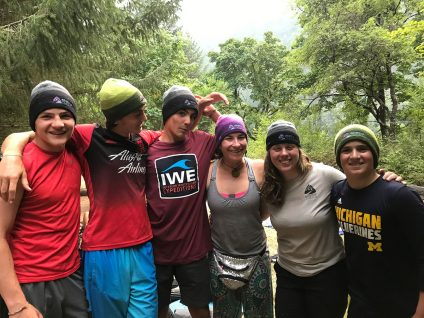 teenage boys and young adult women hiking in british columbia